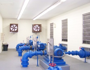 Inside of Water Treatment Plant with Pipes and Two Exhaust Fans